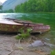 Boats on the Shore of the Taiga River in the Foothills of the Mountains - VideoHive Item for Sale