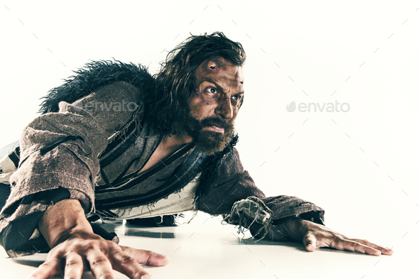 Portrait of a brutal bald-headed viking in a battle mail posing against a white background. - Stock Photo - Images