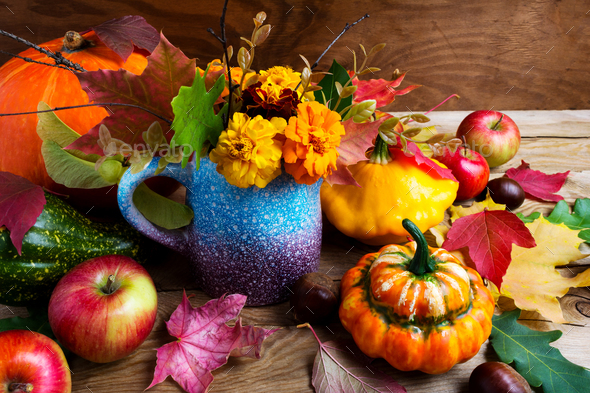 Rustic fall  table centerpiece with pumpkins and leaves, close u - Stock Photo - Images