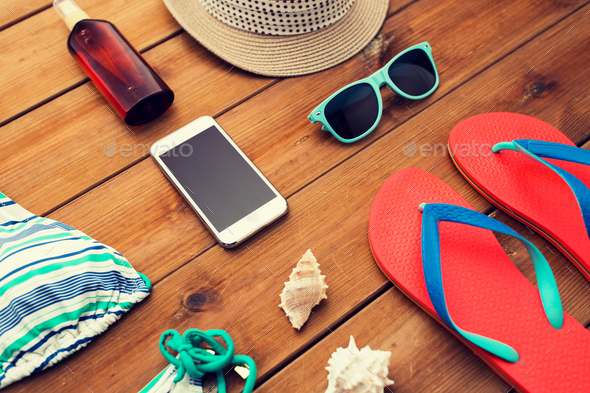 close up of smartphone and beach stuff - Stock Photo - Images