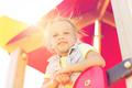 happy little girl on children playground