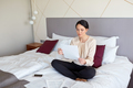 businesswoman with papers working at hotel room