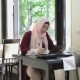 Beautiful Muslim Woman in Cafe with Tablet - VideoHive Item for Sale