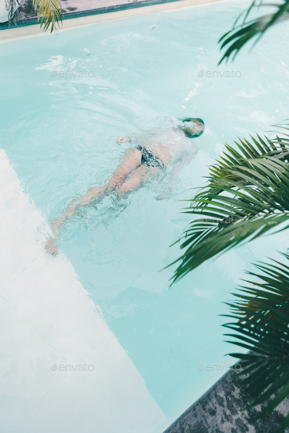 Beautiful young woman at swimming pool - Stock Photo - Images