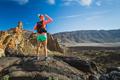 Woman hiker reached mountain top, backpacker adventure