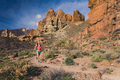 Woman running in mountains, trail runner