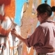 Beautiful Young Girl Making a Colorful Graffiti with Aerosol Spray on Urban Street Wall. Cinematic - VideoHive Item for Sale