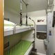 Train berth indoor with two beds. Travel background. Vertical - PhotoDune Item for Sale