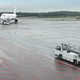 Airport runaway with airplane on a rainy day. Travel background - PhotoDune Item for Sale