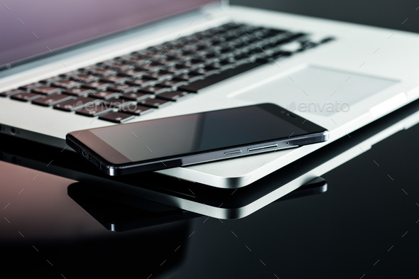 Smartphone and laptop. - Stock Photo - Images