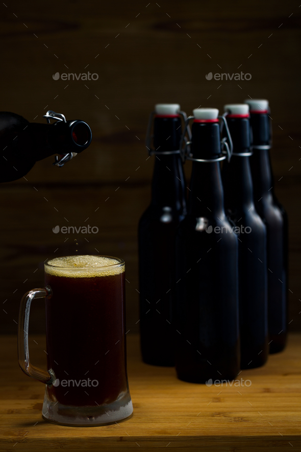 Beer glasses and beer bottles on a wooden background - Stock Photo - Images
