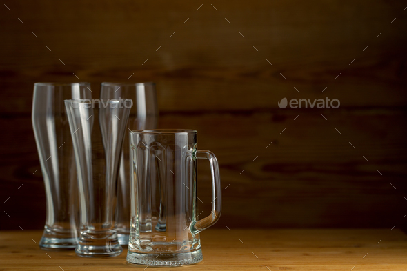 Beer glasses on a wooden background - Stock Photo - Images