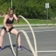 Free Download Athletic Female Working Out Using Battle Ropes. Crossfit. Nulled