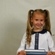 Attractive Schoolgirl Holding a Pile of Books. Portrait of School Child in Uniform. - VideoHive Item for Sale