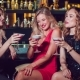 Beautiful Girls Are Sitting on the Bar Having Fun and Drinking Cocktails. - VideoHive Item for Sale