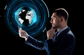 businessman with tablet pc and virtual globe