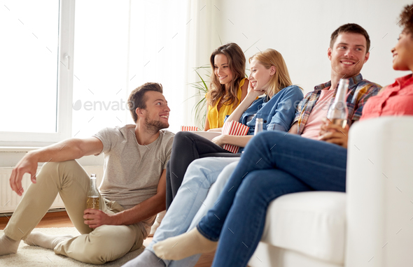happy friends with popcorn and beer at home - Stock Photo - Images