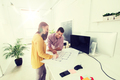 creative team with blueprint working at office