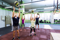 group of people with medicine ball training in gym