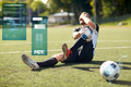 injured soccer player with ball on football field
