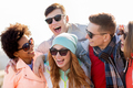 happy teenage friends in shades laughing outdoors