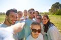 group of volunteers taking selfie by smartphone