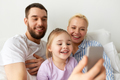 happy family taking selfie by smartphone at home - PhotoDune Item for Sale
