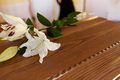 lily flower on wooden coffin at funeral in church - PhotoDune Item for Sale