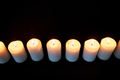 candles burning in darkness over black background - PhotoDune Item for Sale
