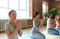 group of people meditating at yoga studio - PhotoDune Item for Sale