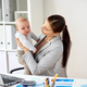 happy businesswoman with baby and laptop at office - PhotoDune Item for Sale