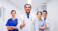 medics or doctors at hospital showing thumbs up - PhotoDune Item for Sale