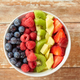close up of fruits and berries in bowl - PhotoDune Item for Sale