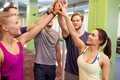 group of happy friends making high five in gym - PhotoDune Item for Sale
