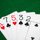poker hand of playing cards on green casino cloth - PhotoDune Item for Sale