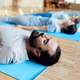 man with group of people doing yoga at studio - PhotoDune Item for Sale