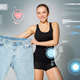 young slim sporty woman showing large size pants - PhotoDune Item for Sale