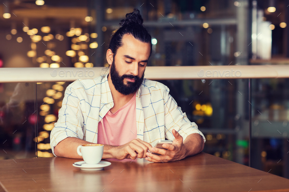 man with smartphone and coffee at restaurant - Stock Photo - Images