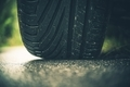 Modern Car Tire on the Road