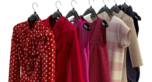 Women's and men's clothing on hangers