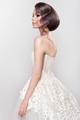 Beautiful bride with fashion wedding hairstyle - on white background.
