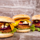 Delicious tasty burgers on wooden background - PhotoDune Item for Sale