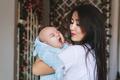 Portrait of a cute asian baby boy yawning