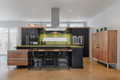 Modern kitchen with green quartz counter top