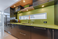 Modern kitchen with green quartz counter top close-up