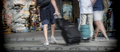 Several travellers with suitcases moving fast in station, conceptual image - PhotoDune Item for Sale