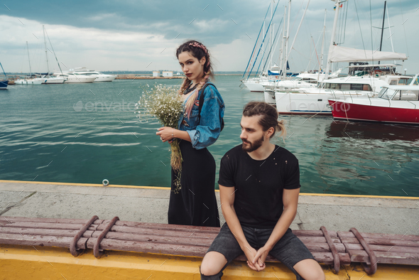 Guy and girl on pier - Stock Photo - Images