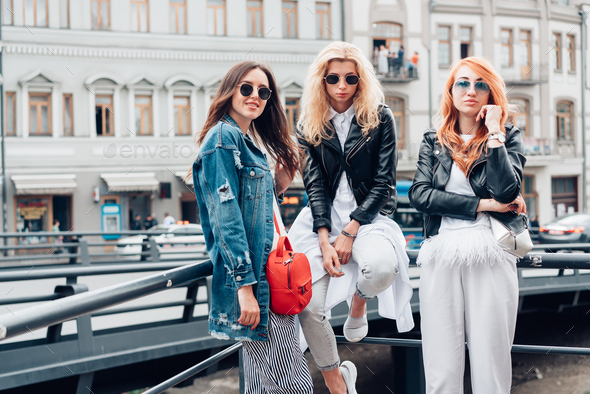 three beautiful girls on the street - Stock Photo - Images