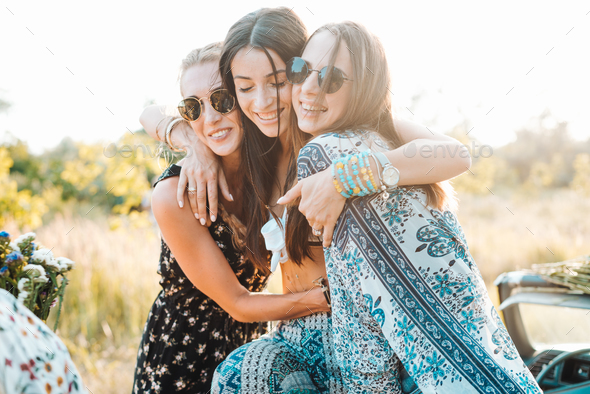Three young girls posing on camera - Stock Photo - Images