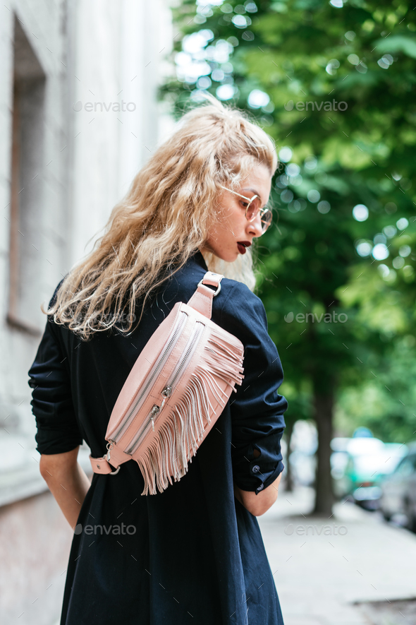 Blonde woman with a bag - Stock Photo - Images